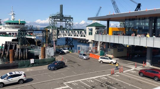 Vehicles unload from a ferry at Colman Dock on Monday.