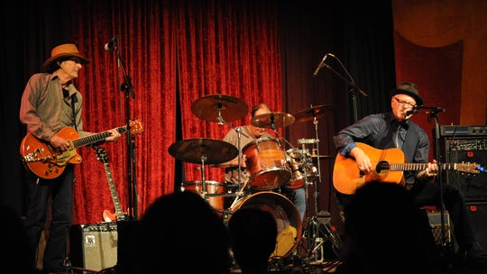 Scott MacDonald (left) on stage with Bill Carter and drummer Rick Tassin.