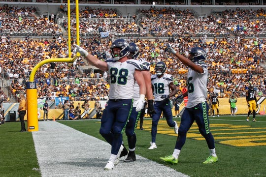 Seattle Seahawks tight end Will Dissly  celebrates with teammates after making a touchdown catch against the Pittsburgh Steelers Sunday, Sept. 15, 2019, in Pittsburgh.