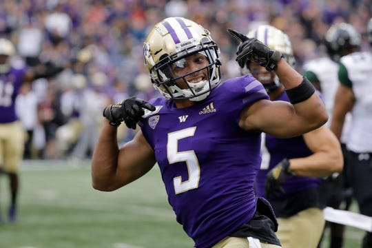Washington defensive back Myles Bryant celebrates after he intercepted a pass against Hawaii during the first half Saturday in Seattle.