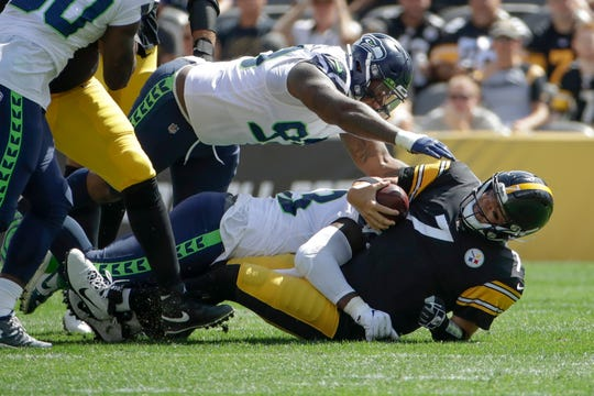 Pittsburgh Steelers quarterback Ben Roethlisberger is sacked by Seattle Seahawks defensive ends Rasheem Green and Jadeveon Clowney in the first half Sunday, Sept. 15, 2019, in Pittsburgh.