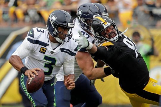 Seattle Seahawks quarterback Russell Wilson scrambles past Pittsburgh Steelers defensive end Cameron Heyward during the Seahawks 28-26 win.