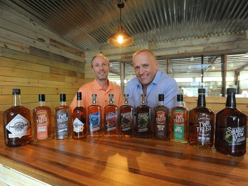 Chad Slagle, right, and John Anderson are two of the seven partners behind Two Trees Distilling Co. The Fletcher distillery incorporates a technology, designed by Slagle and his longtime friend Keith Mort, that drastically reduces the aging process of whiskey.