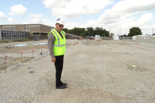 Wynford Superintendent Fred Fox  points out features of what will be the new building's academic wing as construction continues on Wynford's new junior high/high school building on Monday.