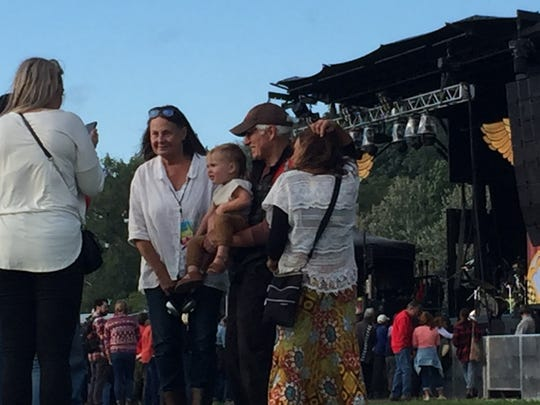 Grace Potter's parents, Peggy and Sparky Potter, stand with Grace Potter's son, 20-month-old Sagan, at Waterfront Park during the Grand Point North festival on Sept. 14, 2019.