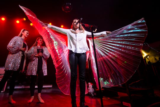 Grace Potter puts on fairy wings borrowed from an audience member during day 2 of the Grand Point North music festival at Waterfront Park on Sunday, Sept.15, 2019 in Burlington, Vermont.