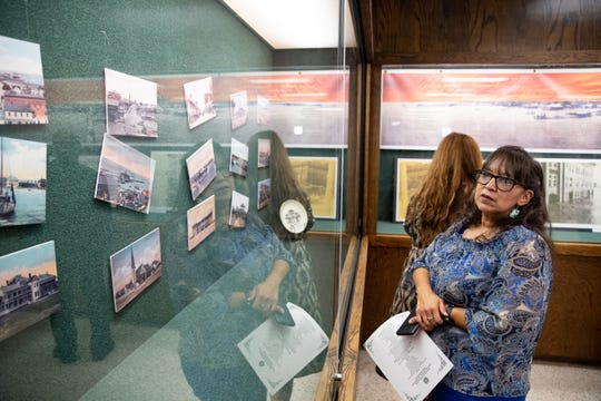 Liz Quintanilla looks at photos of Corpus Christi before the 1919 hurricane on display in the Nueces County Courthouse to commemorate the 100th anniversary of the 1919 storm on Monday, Sept. 16, 2019.