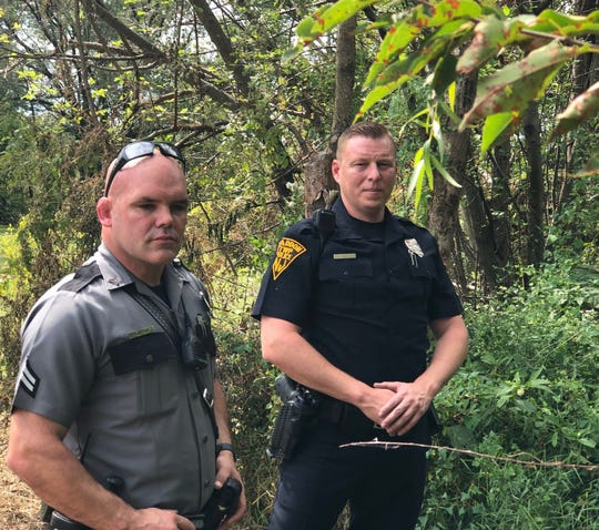 Collingswood Officer Kenneth Jacoby (left) and Haddon Township Officer William Moore teamed up recently on a water rescue at the Cooper River. They contended with thick brush and nighttime conditions to save a kayaker who had fallen in the water and couldn't swim.