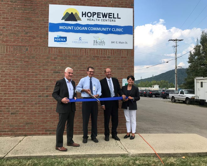 (L-R) Adena Health Systems CEO Jeff Graham, Hopewell Health Centers CEO Mark Bridenbaugh, Chillicothe City School District Board of Education President Steve Mullins and Superintendent Debbie Swinehart cut the ribbon at the opening of the Mount Logan Community Clinic on Thursday, Sep. 12.