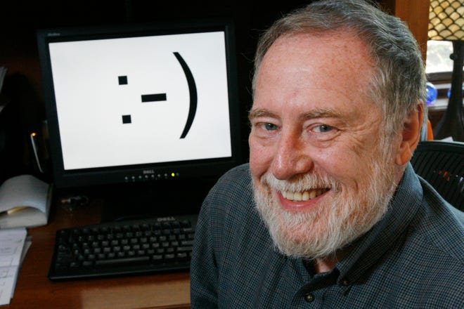 """Carnegie Mellon professor Scott E. Fahlman is shown in his home office on Monday, Sept. 17, 2007, in Pittsburgh. Twenty-five years ago, three keystrokes _ a colon followed by a hyphen and a parenthesis _ were first used as a horizontal """"smiley face"""" in a computer message by Fahlman, the university said.  Fahlman posted the emoticon in a message to an online electronic bulletin board at 11:44 a.m. on Sept. 19, 1982."""
