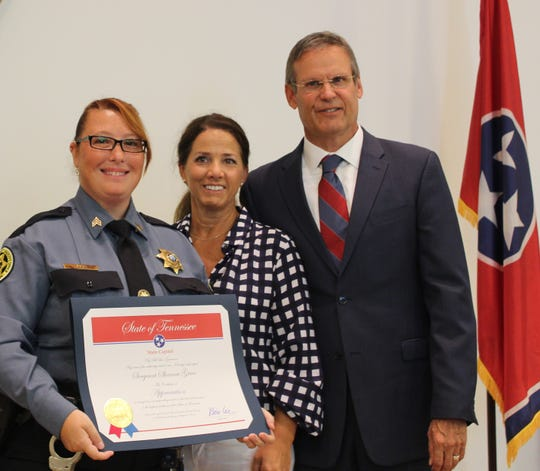 Sgt. Shanna Grice, Maria Lee and Gov. Bill Lee as Grice is presented the First Responder Award during a ceremony in Nashville on Sept. 11, 2019.