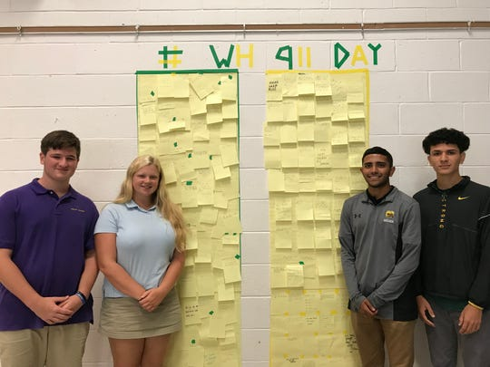 Wardlaw+Hartridge seniors Ryan Brace of Scotch Plains, Kallie Schildge of Westfield, Gunvhir Singh of Carteret and Alejandro Tobar of Westfield gather around the taped outline of the twin towers, which include post-it notes with acts of kindness supplied by Upper School students.
