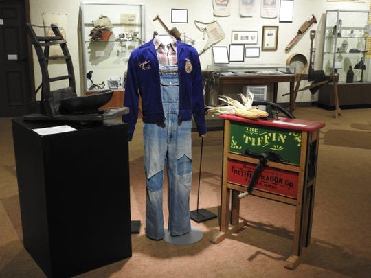A sheep sheering seat, FFA jacket, farm clothes and a corn sheller are some of the items on display at the Johnson-Humrickhouse Museum honoring 100 years of the Ohio Farm Bureau.