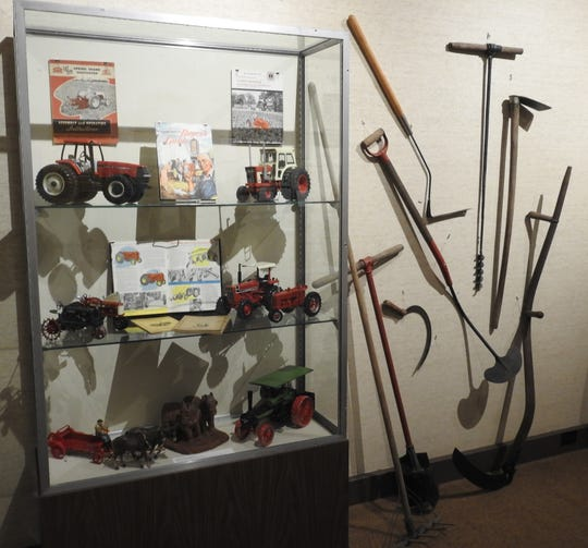 Farm toys and tools are part of the display at the Johnson-Humrickhouse Museum.