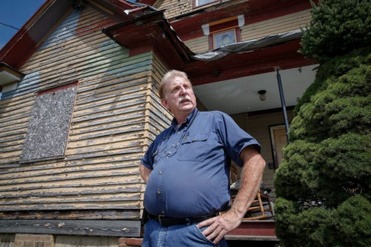 Despite making numerous repairs to this house on 19th Street in Des Moines, property owner and manager Cal Sale said the city of Des Moines has been harassing him to speed up making the repairs.