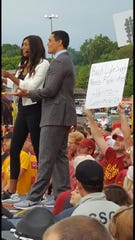"Carson King holds up his ""Busch Light Supply Needs Replenished"" sign behind the stage at ESPN's ""College GameDay"" event at the Cy-Hawk game in Ames on Sept. 14."