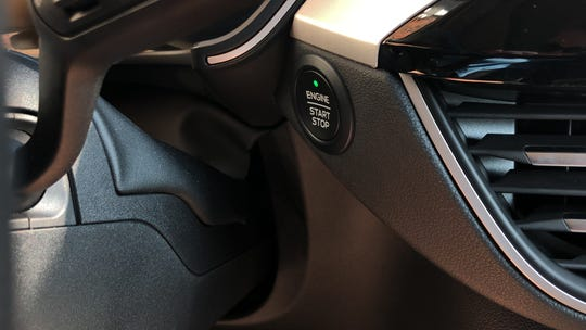 The 2020 Escape's start button is nearly hidden.
