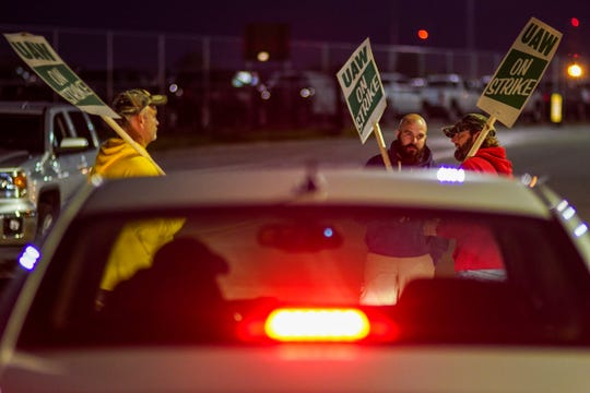 Workers slow a long line of cars from entering Flint Metal Center and Flint Assembly on Monday, September 16, 2019 during a national strike against General Motors after stalled contract negotiations.