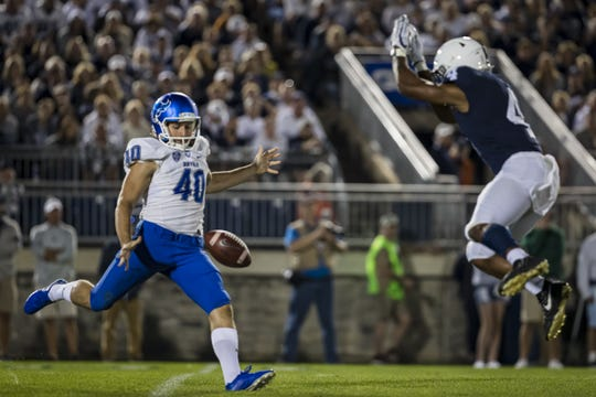 Penn State running back Journey Brown tips a punt by Buffalo punter Evan Finegan in the third quarter on Saturday, Sept. 7, 2019, in State College, Pennsylvania. Finegan was injured on the play and carted off the field.