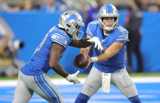 Detroit Lions quarterback Matthew Stafford hands off to Detroit Lions running back Kerryon Johnson during the first half Sunday, Sept. 15, 2019 at Ford Field.