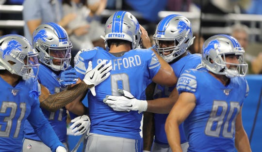 Lions quarterback Matthew Stafford celebrates with teammates during the second half vs. the Chargers.