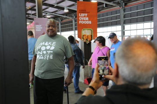 Michael Layne snaps a photo of chef Phil Jones at the Make Food Not Waste event in Detroit's Eastern Market on Sunday, Sept. 8, 2019. Layne's public relations firm, Marx Layne & Company, provided Make Food Not Waste with pro-bono PR to help spread the word about the event.