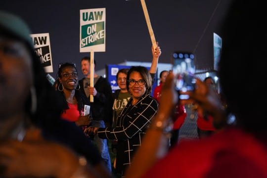 Flint Mayor Karen Weaver stops by to take a photo with UAW members standing outside Flint Assembly as workers leave Flint Assembly early Monday, September 16, 2019 while taking part in a national strike against General Motors after stalled contract negotiations with General Motors.