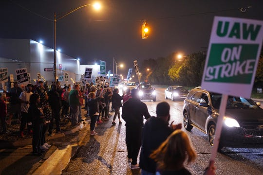Workers leave Flint Assembly plant in Flint, Michigan, early Monday, Sept. 16, 2019, while taking part in a national strike against General Motors after stalled contract negotiations with General Motors. The workers are on the first national UAW strike since 2007.