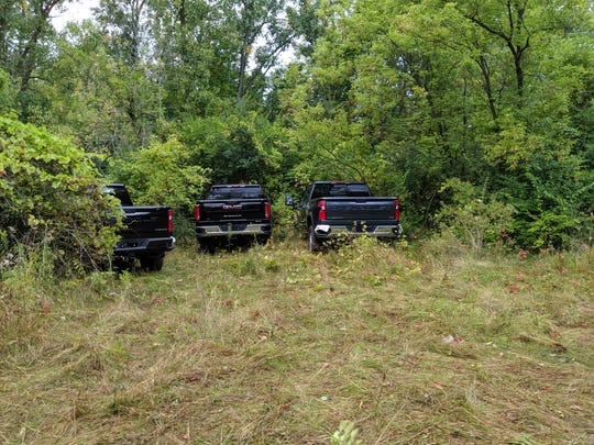Police recovered several trucks in the woods behind an elementary school.