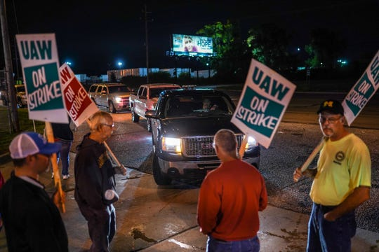UAW members block traffic from entering Flint Engine Operations on Monday, September 16, 2019 during a national strike against General Motors after stalled contract negotiations.The workers are on the first national UAW strike†since 2007.