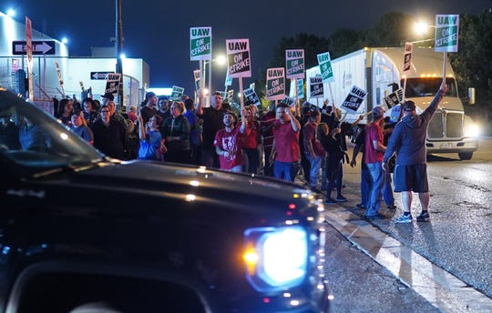 Workers leave Flint Assembly plant early Monday, September 16, 2019 while taking part in a national strike against General Motors after stalled contract negotiations with General Motors.