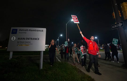 """Chaz Akers, 24, of Ferndale, and a production worker at Detroit-Hamtramck, said """"This is long overdue"""" as he walks with his UAW brothers and sisters strikers with Local 22 outside of GM Detroit-Hamtramck Assembly Monday, Sept. 16, 2019."""