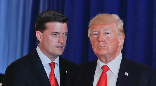 """In this Aug. 12, 2017, photo, Rob Porter, left, White House Staff Secretary, speaks to President Donald Trump. The White House has instructed Porter and another former aide to Trump not to appear at a House Judiciary Committee hearing Tuesday, Sept. 17, 2019, saying Porter and Rick Dearborn are """"absolutely immune"""" from testifying at what the panel is calling its first impeachment hearing."""
