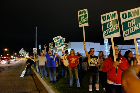 UAW workers at the Flint Assembly Plant picket outside the plant early Monday in Flint.