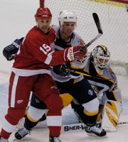 Greg Johnson, playing for Nashville, battles Steve Yzerman in front of the net during a game in 2004.