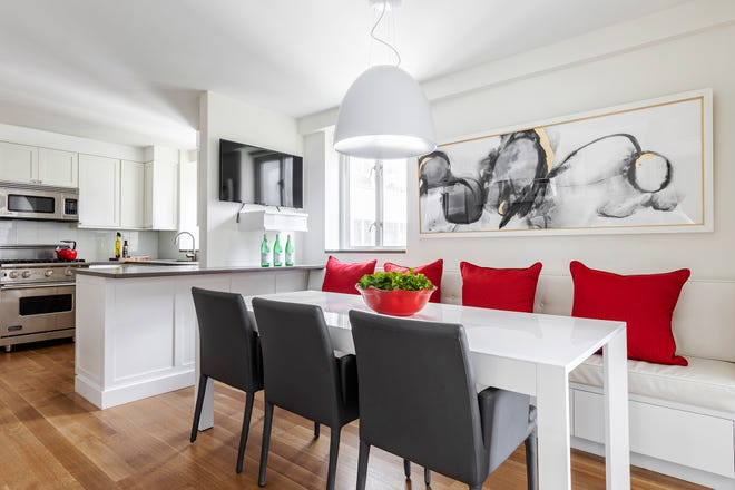Ruby red is the highlight of this all white kitchen.