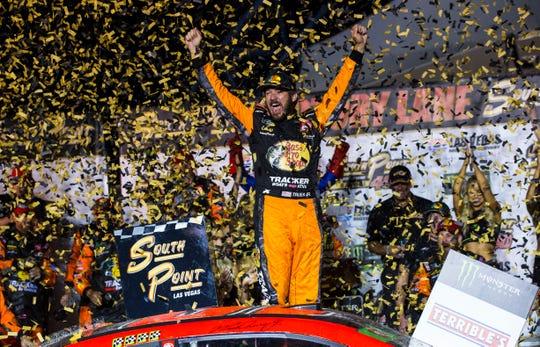 Martin Truex Jr. celebrates after winning a NASCAR Cup Series auto race Sunday at the Las Vegas Motor Speedway.