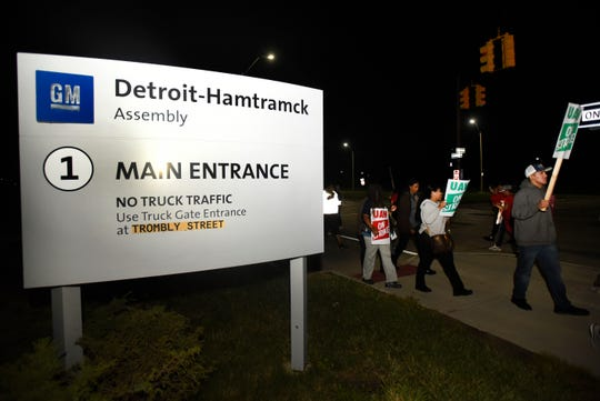 United Auto Workers members picket outside General Motors Co.'s Detroit-Hamtramck Assembly Plant on Day One of the union's national strike against the automaker.