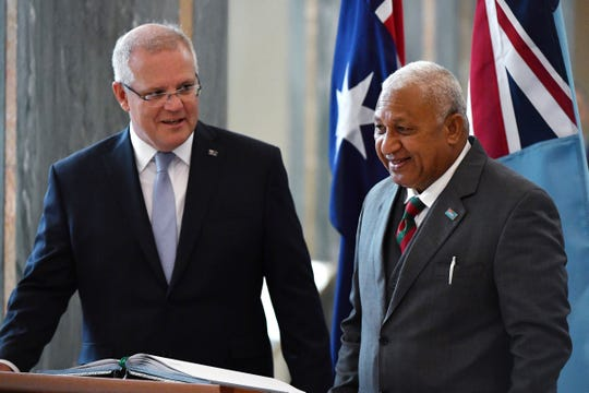 Australia's Prime Minister Scott Morrison, left, with Fiji's Prime Minister Voreqe Bainimarama on Monday.