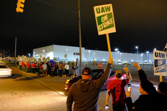 UAW workers at the Flint plant walk out just before midnight Sunday.