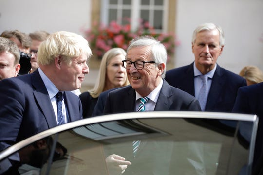British Prime Minister Boris Johnson, left, and European Commission President Jean-Claude Juncker depart after a meeting in Luxembourg, Monday, Sept. 16, 2019.