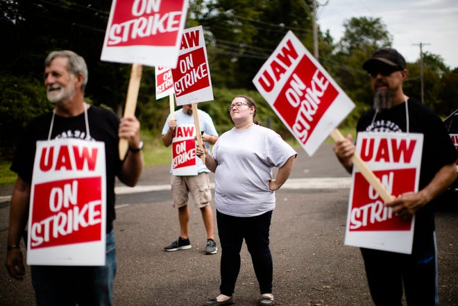 Kelly McKinnon and other workers and their supporters demonstrate outside a General Motors facility in Langhorne, Pa., Monday, Sept. 16, 2019. More than 49,000 members of the United Auto Workers walked off General Motors factory floors or set up picket lines early Monday as contract talks with the company deteriorated into a strike.