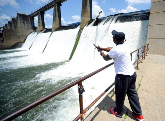 In this Tuesday, July 9, 2019 photo, Brad Shaw fishes at the Heflin Lock and Dam along the Tennessee-Tombigbee Waterway in Epes, Ala. The 234-mile-long stream is a haven for anglers and boaters.