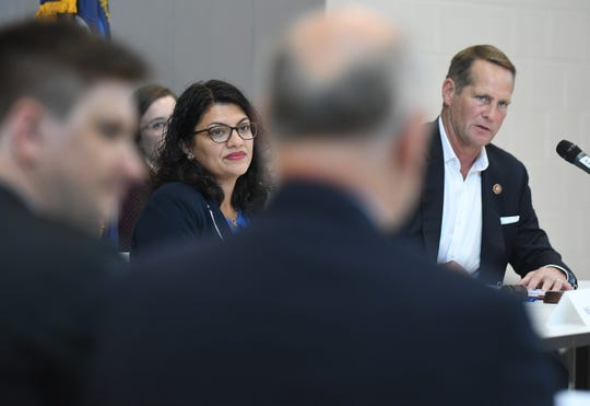 U.S. Reps. Rashida Tlaib of Detroit and Harley Rouda of California listen to witnesses during a congressional hearing concerning air and water conditions in southwest Detroit at the Kemeny Recreation Center in Detroit in September.