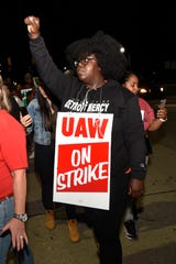 Members of the United Auto Workers picket outside the GM Detroit-Hamtramck Assembly plant on Monday, Sept. 16, 2019, in Hamtramck, Mich.