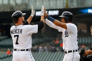 Detroit Tigers' Jordy Mercer (7) celebrates his two-run home run with Victor Reyes in the first inning.