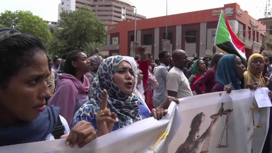 In this frame grab from video, Sudanese rally on the streets of the capital, in Khartoum, Sudan, Thursday, Sept. 12, 2019.