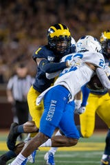 Michigan defensive back Ambry Thomas worked his way back from a bout with colitis in time to play in the season opener against Middle Tennessee State.