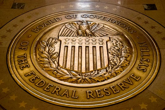 In this Feb. 5, 2018, file photo, the seal of the Board of Governors of the United States Federal Reserve System is displayed in the ground at the Marriner S. Eccles Federal Reserve Board Building in Washington.
