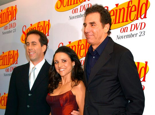 "In this Nov. 17, 2004, file photo Jerry Seinfeld Julia Louis Dreyfus and Michael Richards arrive to celebrate the release of the first three seasons of Seinfeld on DVD in New York. Netflix says it will start streaming all 180 episodes of the ""Seinfeld"" in 2021."